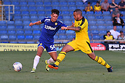 Jamie Shackleton (54) of Leeds United is tackled during the Pre-Season Friendly match between Oxford United and Leeds United at the Kassam Stadium, Oxford, England on 24 July 2018. Picture by Graham Hunt.