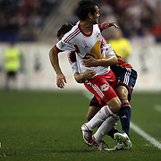 Fabian Espindola, New York Red Bulls, (left), and AJ Soares, New England Revolution, during a tussle for the ball which led to both players receiving a yellow card during the New York Red Bulls V New England Revolution, Major League Soccer regular season match at Red Bull Arena, Harrison, New Jersey. USA. 5th October 2013. Photo Tim Clayton
