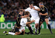 © Andrew Fosker / Seconds Left Images 2011 - England's Jonny Wilkinson is bend backwards with tackles by Scotland's Joe Ansbro (L) & Scotland's John Barclay  - England's Matt Stevens & Scotland's Euan Murray are right  England v Scotland - Rugby World Cup 2011 - Eden Park - Auckland - New Zealand - 01/10/2011 -  All rights reserved..