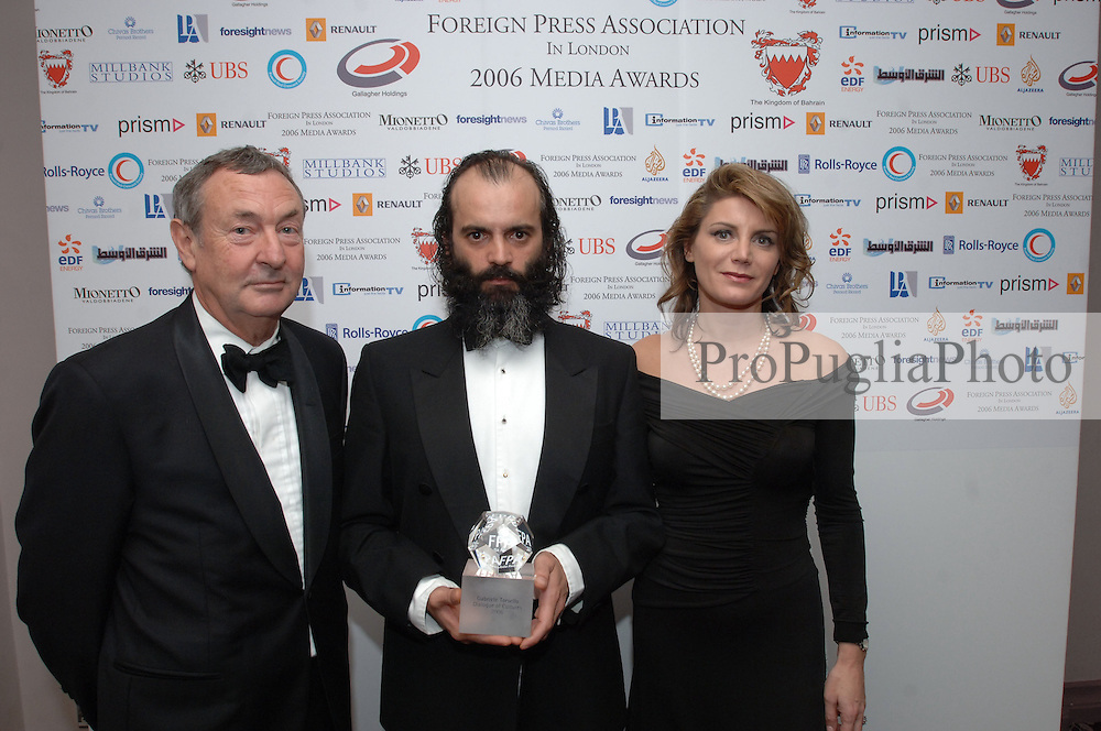 Gabriele Torsello (Kash), Winner of Dialogue of Cultures Award...Annalisa Piras, FPA President...Nick Mason, Pink Floyd. ....THE FOREIGN PRESS ASSOCIATION IN LONDON 11 CARLTON HOUSE TERRACE LONDON SW1Y 5AJ TELEPHONE + 44 (0) 20 7930 0445 Press Release 28 November 2006 The Foreign Press Association (FPA) 2006 Media Awards Winners.......Murdered Russian journalist, Anna Politskovskya, and Italian-born/British-resident photojournalist, Gabriele ?Kash? Torsello, recently kidnapped by the Taleban in Afghanistan, were among the award-winners at tonight?s Foreign Press Association 2006 Media Awards. ....?Journalist of the Year? was Dominic Waghorn of Sky News, for his report ?China: Human Rights?, in which interviewees risked their lives and Waghorn was physically assaulted three times to get his extraordinary report.....The FPA is the world?s oldest foreign correspondents? club, and the Association?s Media Awards are the only opportunity for the British media to be judged and rewarded by their international counterparts based in London. ....The record number of entries to this year?s competition, confirm the rising status and importance of the FPA Media Awards to the British media. The almost 200 entries were judged by a panel of senior foreign correspondents, and three external judges: Kate Adie, Trevor Kavanagh and Peter Preston. ....The 2006 FPA Media Awards ceremony took place at the Sheraton Park Lane Hotel, in the presence of HRH The Duke of Gloucester, and hosted by Annalisa Piras, President, Foreign Press Association, who welcomed the keynote speaker, the Rt Hon Margaret Beckett MP, Secretary of State for Foreign and Commonwealth Affairs......The FPA?s Premier Award, the ?Dialogue of Cultures? Award, for organisations or individuals who make an exceptional contribution to enhancing understanding between peoples, was won by Gabriele Torsello, known as ?Kash?. Making his first public appearance since being released by the Taleban earlier this month, Kash has compass