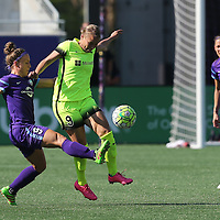Orlando Pride forward Josee Belanger (9) kicks the ball past Seattle Reign FC midfielder Merritt Mathias (9) right, during a NWSL soccer match at Camping World Stadium on May 8, 2016 in Orlando, Florida. (Alex Menendez via AP)