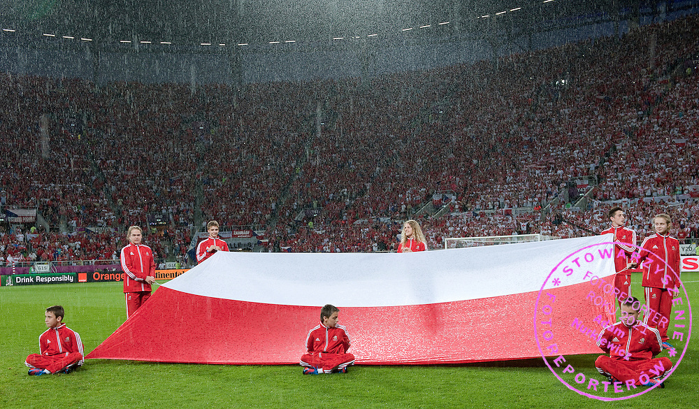 Children hold Polish flag while national anthem before the UEFA EURO 2012 Group A football match between Poland and Czech Republic at Municipal Stadium in Wroclaw on June 16, 2012...Poland, Wroclaw, June 16, 2012..Picture also available in RAW (NEF) or TIFF format on special request...For editorial use only. Any commercial or promotional use requires permission...Photo by © Adam Nurkiewicz / Mediasport