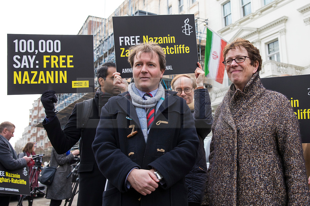 © Licensed to London News Pictures. 21/02/2018. London, UK. Richard Ratcliffe (centre), husband of Nazanin Zaghari-Ratcliffe, joins protesters outside the Iranian Embassy in London, ahead of an expected visit by a senior Iranian minister. British-Iranian Nazanin Zaghari-Ratcliffe has been detained in Iran since April 2016. Photo credit: Rob Pinney/LNP