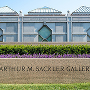 Sackler Gallery Building with Sign. The Independence Avenue side of the Arthur M. Sackler Gallery. The Sackler Gallery, located behind the Smithsonian Castle, showcases ancient and contemporary Asian art. The gallery was founded in 1982 after a major gift of artifacts and funding by Arthur M. Sackler. It is run by the Smithsonian Institution.