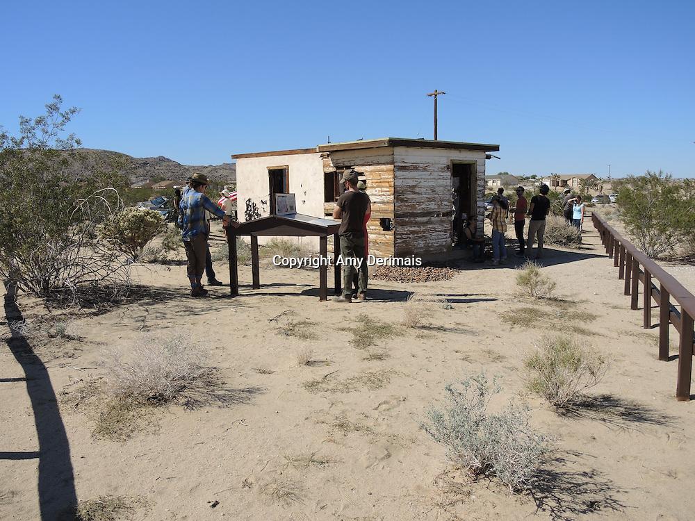 "High Desert Test Sites 2013, Eames Demetrios, ""Kcymaerxthaere Story Telling"" visitors exploring Krblin Jihn Cabin in Joshua Tree."