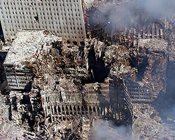 Sep 17, 2001 - New York, New York, U.S. - An aerial view shows only a small portion of Ground Zero, the crime scene where the World Trade Center collapsed following the Sept. 11 terrorist attacks. Surrounding buildings were heavily damaged by the debris and massive force of the falling twin towers. On the morning of  September 11, 2001, nineteen al-Qaeda terrorists hijacked four commercial passenger jet airliners. The hijackers intentionally crashed two of the airliners into the Twin Towers of the World Trade Center in New York City, the 1st at 8:46 a.m., American Airlines Flight 11 was crashed into the World Trade Center's North Tower, followed by United Airlines Flight 175, which hit the South Tower at 9:03 a.m, killing everyone on board and many others working in the buildings. Both towers collapsed within two hours, destroying nearby buildings and damaging others. Among the 2,752 victims who died in the attacks on the World Trade Center were 343 firefighters and 60 police officers from New York City and the Port Authority..(Credit Image: © Eric J. Tilford/U.S. Navy/ZUMAPRESS.com)