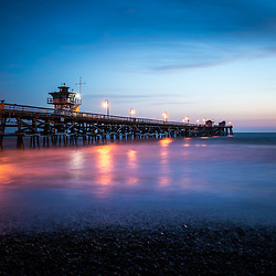 San Clemente pier at sunset. San Clemente is a popular beach city in Orange County in Southern California in the United States of America. Copyright ⓒ 2017 Paul Velgos with all rights reserved.