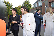 PETER BRANT JNR;  HARRY BRANT, Serpentine's Summer party co-hosted with Christopher Kane. 15th Serpentine Pavilion designed by Spanish architects Selgascano. Kensington Gardens. London. 2 July 2015.