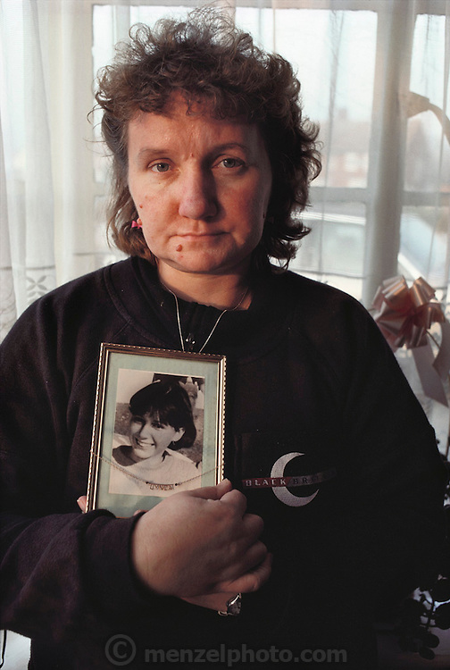 (1992) Mrs. Kath Eastwood, Mother of Lynda Mann, holding a picture of her daughter in her living room in Enderby, UK. Lynda Mann was raped/murdered by Colin Pitchfork. The case was the first to be broken by DNA fingerprinting. 2,000 young men in the village gave blood to clear their names. Colin Pitchfork paid a co-worker to take the test and was later caught because of this attempted deception. DNA Fingerprinting. MODEL RELEASED.