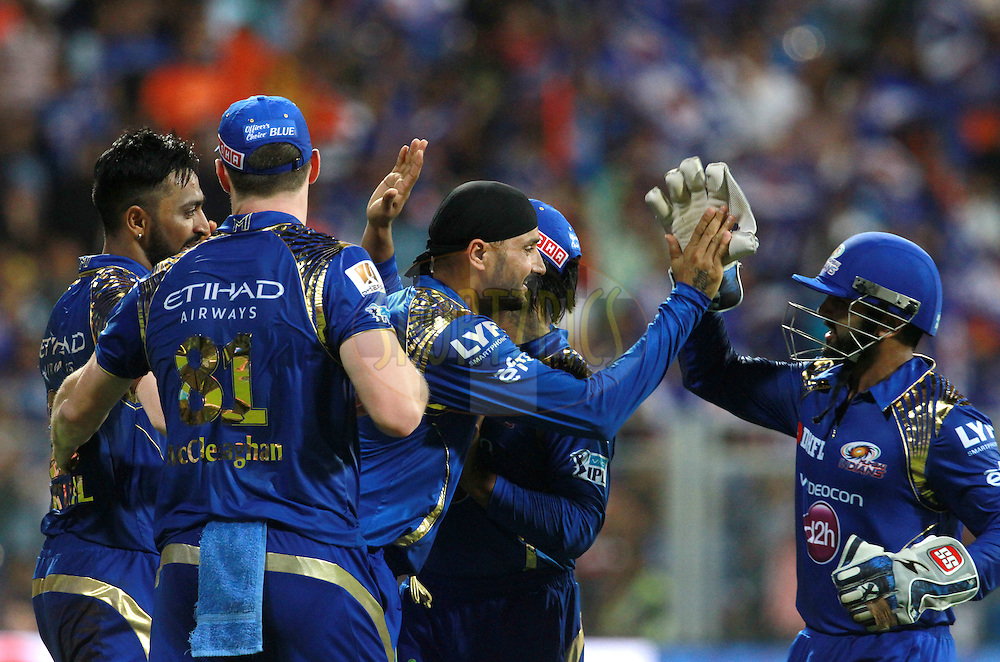 Mumbai Indians players celebrates the wicket of Gujarat Lions player Dinesh Karthik during match 9 of the Vivo Indian Premier League ( IPL ) 2016 between the Mumbai Indians and the Gujarat Lions held at the Wankhede Stadium in Mumbai on the 16th April 2016<br /> <br /> Photo by Vipin Pawar/ IPL/ SPORTZPICS