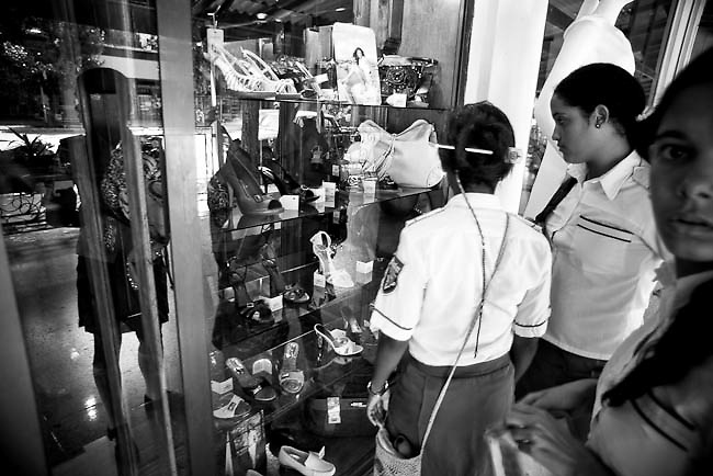 "America, Cuba, Havana. A group of young girls sees the articles in a store, most of this are sold in Pesos Covertibles. The convertible peso informally called a chavito, is one of two official currencies in Cuba, the other being the peso. It has been in limited use since 1994, when it was treated as equivalent to the U.S. dollar. On November 8, 2004, the U.S. dollar ceased to be accepted in Cuban retail outlets leaving the convertible peso as the only currency in circulation in many Cuban businesses. Officially exchangeable only within the country. The convertible peso is, by the pegged rate, the tenth-highest-valued currency unit in the world and the highest valued ""peso"" unit  . -02.07.2008, DIGITAL PHOTO, 49MB, copyright: Alex Espinosa/Gruppe28."
