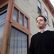 H. Thomas Davis lll with City Block Apartments poses for a portrait in front of 829 N. 4th Street in Wilmington, N.C. The building, which is next door to Davis' current apartment building project is under consideration for renovation after completion of the apartments. (Jason A. Frizzelle)