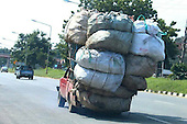TRUCK OVERLOADED WITH 20 BAGS OF RUBBISH ALMOST SNAPS IN HALF