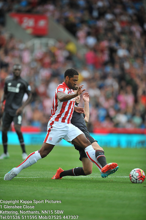 STOKES GLEN JOHNSON BATTLES WITH LIVERPOOLS  ADAM LALLANA, Stoke City v Liverpool, Premiership, Britannia Stadium Sunday 9th August 2015
