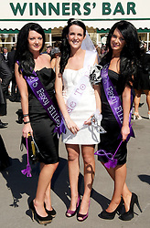 LIVERPOOL, ENGLAND, Thursday, April 7, 2011: Bride to be Kirsty from Wrexham with twin bridesmaids Jessica and Gemma during Ladies' Day on Day Two of the Aintree Grand National Festival at Aintree Racecourse. (Photo by David Rawcliffe/Propaganda)