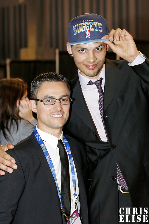 28 June 2012: French player Evan Fournier, picked up by the Denver Nuggets, poses next to Comsport agent Jeremy Medjana during the 2012 NBA Draft, at the Prudential Center, Newark, New Jersey.