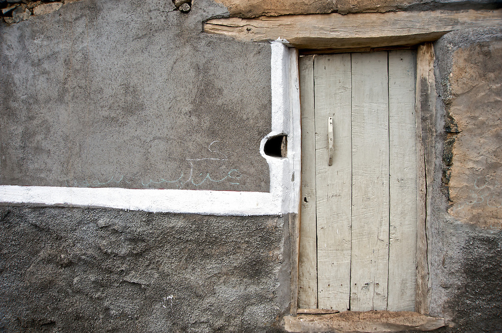 The highest mountain range in North Africa, the High Atlas runs diagonally across Morocco.  The Toubkal region contains the highest peaks.  It is only two hours from Marrakesh.  Here, a door in a village, High Atlas.