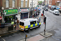 © Licensed to London News Pictures. 24/04/2019. London, UK. A crime scene on Harlesden High Street, Brent in West London where a 21 year old man was stabbed on Tuesday 23 April 2019 at 9.07pm. According to the Met Police, the suspects arrived in two cars before blocking traffic in order to carry out the attack. The victim fled into a bookmakers (Paddy Power) to seek help before the arrival of emergency services. The victim was pronounced dead at a hospital at 2.47am on Wednesday 24 April 2019. Photo credit: Dinendra Haria/LNP