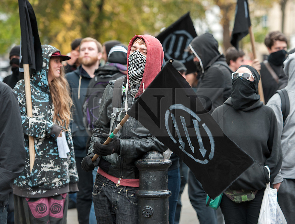 © Licensed to London News Pictures. 17/10/2015. Bristol, UK.  Anti-Fascists on College Green.  Bristol Patriots vs Anti-Fascists twin demonstrations in Bristol city centre.  The Bristol Patriots were marching against 'Somali rape gangs' and immigration, and the Anti-Fascists opposed them.  Violence flared between Anti-Fascists and police who made several arrests. Photo credit : Simon Chapman/LNP