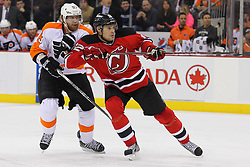 Jan 21; Newark, NJ, USA; New Jersey Devils left wing Alexei Ponikarovsky (12) and Philadelphia Flyers right wing Jakub Voracek (93) battle during the second period at the Prudential Center.