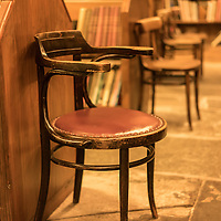 Bookshop interior with chairs in Hay on Wye in Herefordshire, England.