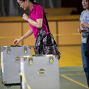 TOKYO, JAPAN - JULY 10 : A woman cast her ballots to vote for parliament's upper house election at a polling station in Tokyo, Japan on Sunday, July 10, 2016. The revised law has expanded the electorate by 2.4 million people aged 18 and 19, and is designed to give more political say to younger generations. The first Upper house election nation-wide in Japan that 18 years old can vote after government law changes its voting age from 20 years old to 18 years old. (Photo by Richard Atrero de Guzman/NUR Photo)