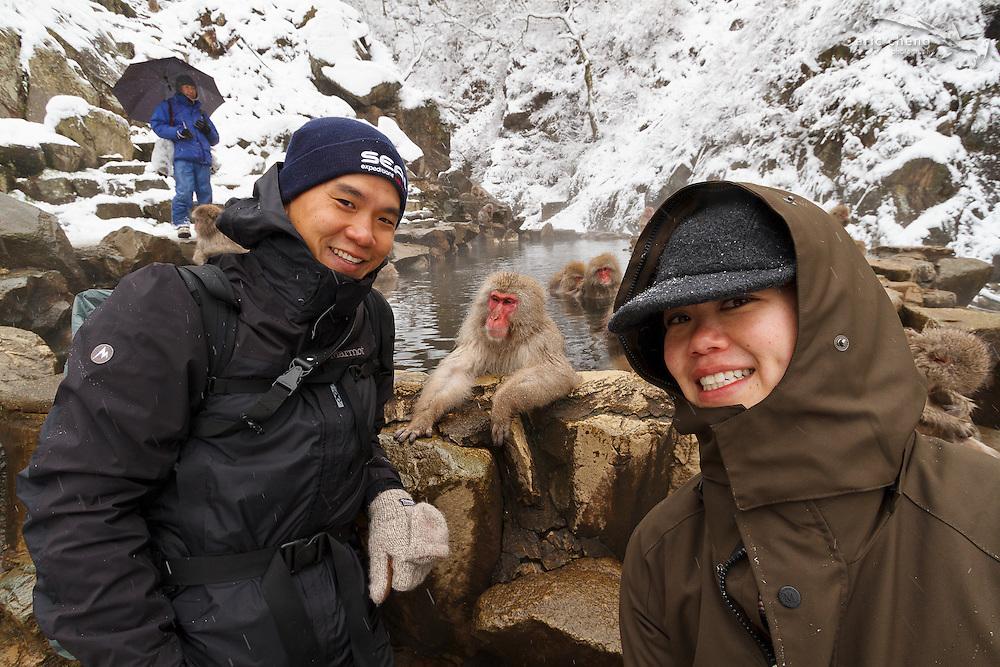 Photographer Eric Cheng and assistant Pam photographing snow monkeys (Japanese macaque, Macaca fuscata). Jigokudani Yaen-Koen near Shibu Onsen, Japan.