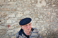 """AFFILE, ITALY - 23 AUGUST 2012: Mariano Palombi, 98, the oldest man of Affile, a town with a population of 1,600 80km east of Rome, on August 23, 2012. A mausoleum and park, dedicated to the memory of Fascist Field Marshall Rodolfo Graziani, has recently been opened in the Italian town of Affile. At a cost of €127,000 to local taxpayers, the mayor Ercole Viri has expressed hope that the site will become as 'famous and as popular as Predappio' – the burial place of Mussolini which has become a shrine to neo-Fascists. Rodolfo Graziani was the youngest colonel in the Regio Esercito (Royal Italian Army), known as the """"Butcher of Fezzan"""" and the """"Butcher of Ethiopia"""" for the brutal military campaigns and gas attacks he led in Libya and Ethiopia under the dictatorship of Benito Mussolini under which he then became Minister of Defence from 1943 to 1945."""
