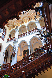 Hluboká, Southern Bohemia:  Entrance hall of Hluboka Chateau.  (From Wikipedia:)  Hluboka is a town in the South Bohemian Region of the Czech Republic, near České Budějovice. This town was a favourite of Charles IV, who often visited when residing in České Budějovice. It is best known for its famous Windsor-style chateau.<br /> <br /> The original royal castle of Přemysl Otakar II from the second half of the 13th century was rebuilt at the end of the 16th century by the Lords of Hradec. It received its present appearance under Count Jan Adam of Schwarzenberg. According to the English Windsor example, architects F. Beer and F. Hluboka Chateau (Castle) : Deworetzky built a Romantic Neo-Gothic chateau, surrounded by a 1.9 square kilometres (0.73 sq mi) English park here in the years 1841 to 1871. The castle is opened to public. There is a winter garden and riding-hall where the Southern Bohemian gallery exhibitions have been housed since 1956.<br /> <br /> The castle has been used in a scene of Jackie Chan and Owen Wilson's Shanghai Knights.