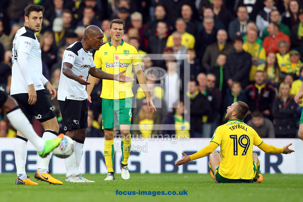 Andre Wisdom of Derby County and Tom Trybull of Norwich clash during the Sky Bet Championship match at Carrow Road, Norwich<br /> Picture by Paul Chesterton/Focus Images Ltd +44 7904 640267<br /> 28/10/2017