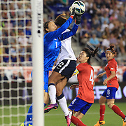 Goalkeeper Kim Jungmi, Korean Republic, saves while challenged by Sydney Leroux, USA, during the U.S. Women Vs Korea Republic friendly soccer match at Red Bull Arena, Harrison, New Jersey. USA. 20th June 2013. Photo Tim Clayton