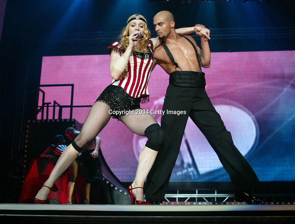 INGLEWOOD, CA - MAY 24:  Singer/actress Madonna performs onstage during the opening night of her &quot;Re-Invention&quot; World Tour 2004 at The Great Western Forum, May 24, 2004 in Inglewood, California.  (Photo by Frank Micelotta/Getty Images) <br />  <br />   *** Local Caption *** Madonna