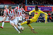 Jason Banton has a shot during the Sky Bet League 2 match between Cheltenham Town and Plymouth Argyle at Whaddon Road, Cheltenham, England on 28 March 2015. Photo by Alan Franklin.