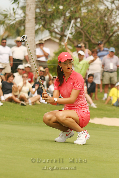 Feb 25, 2006; Kapolei, HI, USA; Michelle Wie reacts after missing a putt during the final round at the inaugural LPGA Fields Open at Ko Olina Resort. ..Photo Credit: Darrell Miho .Copyright © 2006 Darrell Miho