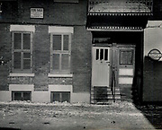 Prostitutes And Madams: Mugshots From When Montreal Was Vice Central<br /> <br /> Montreal, Canada, 1949. Le Devoir publishes a series of articles decrying lax policing and the spread of organized crime in the city. Written by campaigning lawyer Pacifique 'Pax' Plante (1907 – 1976) and journalist Gérard Filion, the polemics vow to expose and root out corrupt officials.<br /> <br /> With Jean Drapeau, Plante takes part in the Caron Inquiry, which leads to the arrest of several police officers. Caron JA's Commission of Inquiry into Public Morality began on September 11, 1950, and ended on April 2, 1953, after holding 335 meetings and hearing from 373 witnesses. Several police officers are sent to prison.<br /> <br /> During the sessions, hundreds of documents are filed as evidence, including a large amount of photos of places and people related to vice.  photos of brothels, gambling dens and mugshots of people who ran them, often in cahoots with the cops – prostitutes, madams, pimps, racketeers and gamblers.<br /> <br /> Photo shows: Prostitution House at 1153-1155 Clark Street, 1940.<br /> ©Archives de la Ville de Montréal/Exclusivepix Media