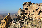Troglodyte cave dwellings carved into the rock at Cavusin, a village between Avanos and Goreme, in Goreme National Park, Nevsehir province, Cappadocia, Central Anatolia, Turkey. The caves were made by carving the soft volcanic tuff created by ash from volcanic eruptions millions of years ago. This area forms part of the Goreme National Park and the Rock Sites of Cappadocia UNESCO World Heritage Site. Picture by Manuel Cohen