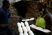 On a wood hoven the baker Afonso makes bread to sell in Vila do Maio (Maio Village).