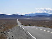Jeep and biker on an endless road in Death Valley National Park, California. Nice drive!