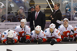 Feb 8, 2012; San Jose, CA, USA; Calgary Flames head coach Brent Sutter stands behind the bench against the San Jose Sharks during the third period at HP Pavilion. Calgary defeated San Jose 4-3. Mandatory Credit: Jason O. Watson-US PRESSWIRE