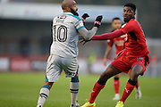Dominic Vose from Grimsby Town and Andre Blackman clash during the EFL Sky Bet League 2 match between Crawley Town and Grimsby Town FC at the Checkatrade.com Stadium, Crawley, England on 26 November 2016. Photo by Jarrod Moore.