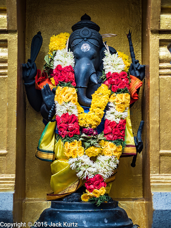 "27 DECEMBER 2015 - SINGAPORE, SINGAPORE: A statue to Sri Yoga Ganapthy at Sri Veeramakaliamman Temple in Singapore. Sri Veeramakaliamman Temple in the ""Little India"" section of Singapore, was one of the first Hindu temples in Singapore and is dedicated to the Goddess Kali, the Hindu ""Destroyer of Evil.""  It's on Serangoon Road, which at one time was the center of Singapore's Indian community and served Indian immigrants who worked in the cattle trade that was based around Serangoon Road in the 19th century. Now the temple is a popular tourist site.     PHOTO BY JACK KURTZ"