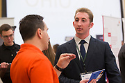Jeff McCann, an IT Manager for Progressive and a '95 Ohio University alum, talks with Nathan Chernomorets at the College of Business Conference on September 7, 2017.