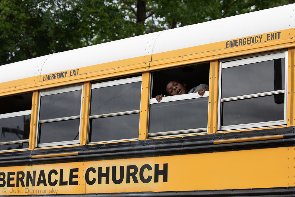 Sunday, March 29, 202, Congregants on buses leave the  Life Tabernacle Church after atteneding a service led by  Pastor Tony Spell  who defied Louisiana Gov. John Bel Edwards shelter-in-place order  despite the coronavirus Pandemic.
