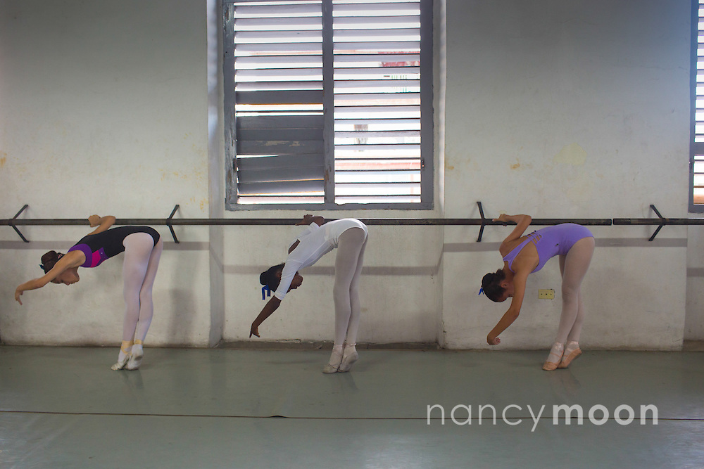 Havana, Cuba ballet school on the outskirts of town, three dancers practice.<br />
