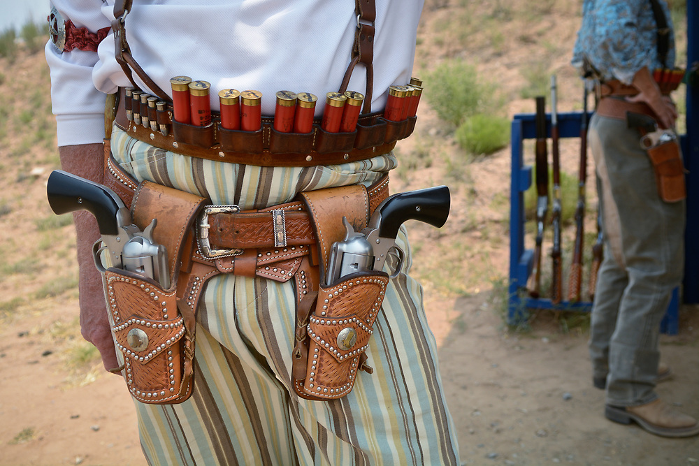 mkb062417h/metro/Marla Brose --  Bill Buckman of Bogata, Texas,  carries pistols in his gunbelt before competing in one stage of The World Championship of Cowboy Action Shooting, Saturday, June 23, 2017, at Founders Ranch in Edgewood,  N.M. About 600 shooters, all dressed in Old West-era attire, brought their pistols, rifles and shotguns to compete in the 36th annual shooting event at  Founders Ranch in Edgewood, N.M.  The public was welcome to watch on Friday and Saturday. The event ends on Sunday, a day which is closed to the public. (Marla Brose/Albuquerque Journal)