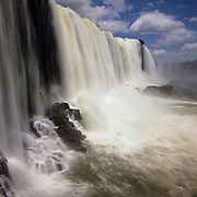South America, Brazil, Igwazu Falls. Igwacu Falls drops gloriously in to the river below.