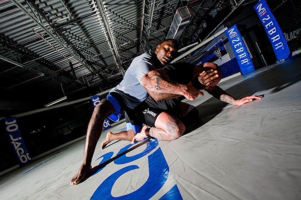 "BOCA RATON, Fla. (April 27, 2015) – MMA fighter Anthony ""Rumble"" Johnson listens to tips from instructor Neil Melanson during training for his upcoming match against Jon Jones - who was replaced by Daniel Cromier after Jones' legal issues - at Jaco Hybrid Training Center in Boca Raton, Florida. (Photo by Chip Litherland for ESPN the Magazine)"