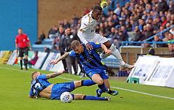 Siriki Dembele of Peterborough United is brought down by Mark Byrne and Barry Fuller of Gillingham - Mandatory by-line: Joe Dent/JMP - 22/09/2018 - FOOTBALL - Medway Priestfield Stadium - Gillingham, England - Gillingham v Peterborough United - Sky Bet League One