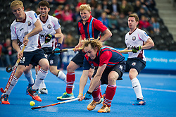 Hampstead & Westminster's Richard Alexander shoots to get their goal. Wimbledon v Hampstead & Westminster - Semi-Final - Men's Hockey League Finals, Lee Valley Hockey & Tennis Centre, London, UK on 22 April 2017. Photo: Simon Parker