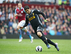BIRMINGHAM, ENGLAND - Easter Sunday, March 31, 2013: Liverpool's Luis Alberto Suarez Diaz in action against Aston Villa during the Premiership match at Villa Park. (Pic by David Rawcliffe/Propaganda)
